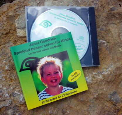 Eine grüne CD mit einem strahlenden Kind.